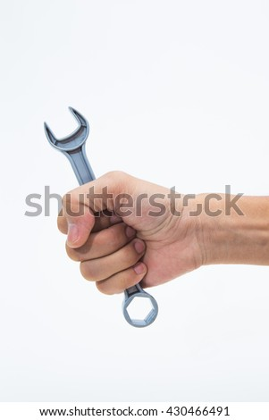 Mechanic hand hold spanner tool in hand - stock photo