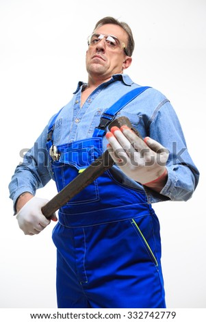 mechanic holding a hammer - stock photo