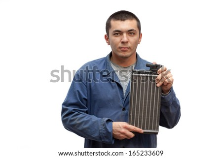 Mechanic in dirty clothes with spare parts on a white background