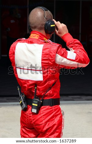 Mechanic in red overall - stock photo