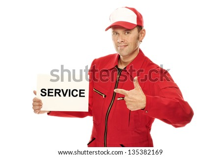 "Mechanic in red Overall pointing to a sign with ""Service"" on it, isolated on white"