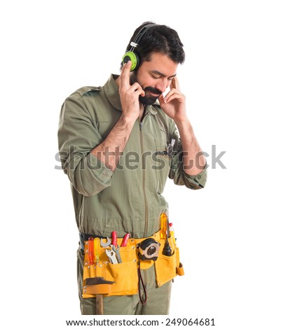 mechanic listening music - stock photo