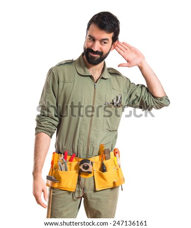 Mechanic listening something  - stock photo