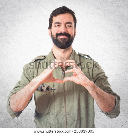 Mechanic making a heart with his hands  - stock photo