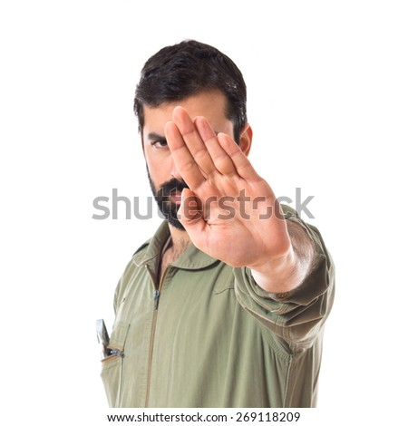 Mechanic making stop sign over white background   - stock photo