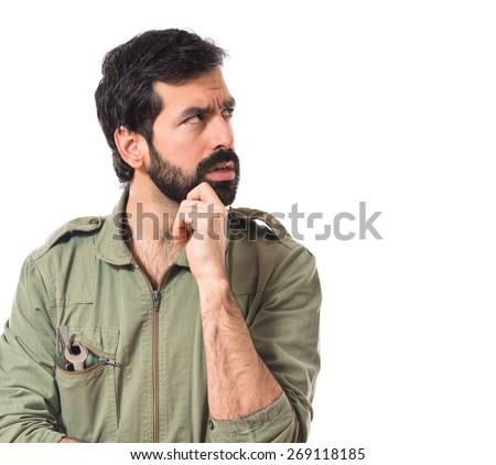 Mechanic thinking over white background   - stock photo