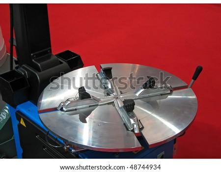 mechanic tool. tyre mounting machine. car mechanic. - stock photo