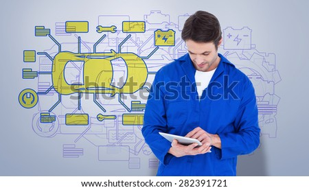 Mechanic using digital tablet over white background against grey vignette - stock photo