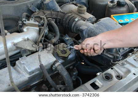 mechanic working on an engine of the car