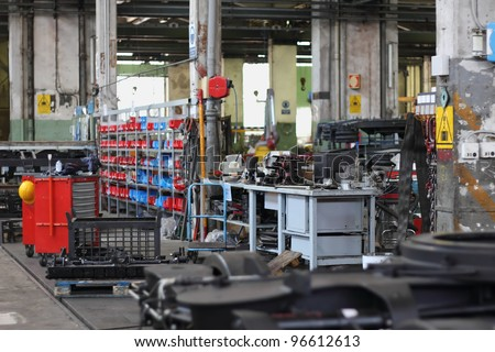 mechanic workshop with tools and machinery - stock photo