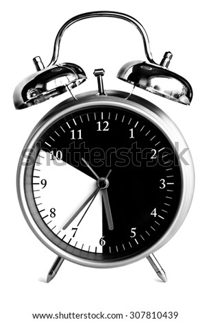 Mechanical alarm clock with black-and-white dial - stock photo