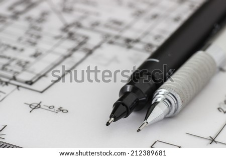 Mechanical and technical pen on a technical drawing - stock photo