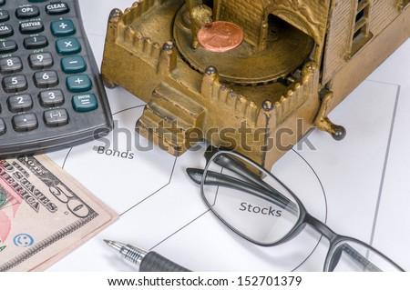 Mechanical Bank & Calculator - stock photo