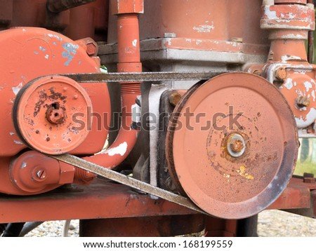 Mechanical belt driven gear wheels on an engine for power transmission from one shaft to another - stock photo