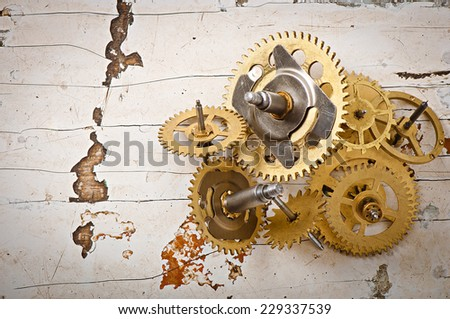 mechanical clock gears on the old wooden table - stock photo
