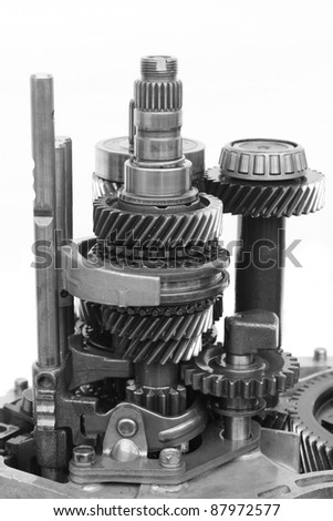 mechanical gear on isolated white background - stock photo