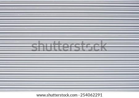 mechanical metal rolling door as background - stock photo