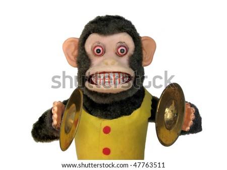 Mechanical monkey toy, upper body isolated on white - stock photo