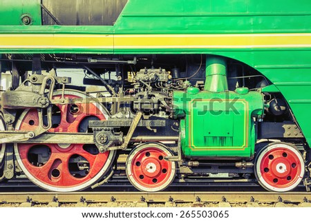 Mechanical part and wheels of the retro steam locomotive. - stock photo