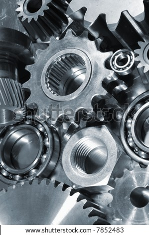 mechanical parts against steel, gears and bearings concept - stock photo
