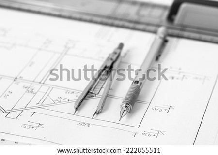Mechanical pencil and divider on a construction plan, technical drawing