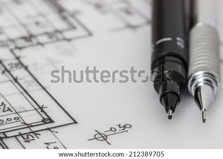 Mechanical pencil on a technical drawing - stock photo