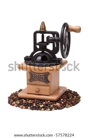 mechanical pepper mill and peppercorn - stock photo