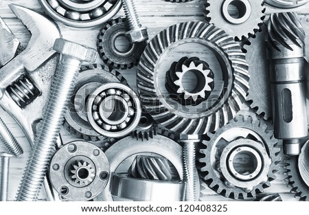 Mechanical ratchets, nuts and bolts - stock photo
