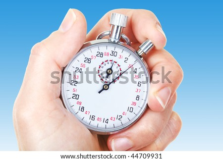 Mechanical stopwatch. Over blue background