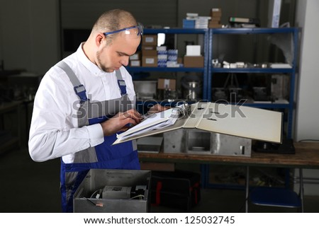 Mechanical technician at work - stock photo