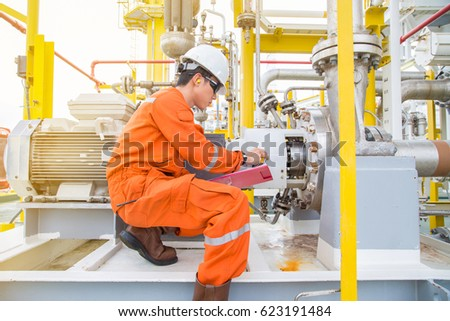 Mechanical technician checking logging data lube stock for Electric motor oil lubrication