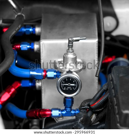 mechanical vehicle compressor,Fuel regulator with spare fuel tank - stock photo