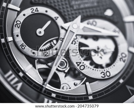 Mechanical watch up close in black and white - stock photo
