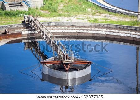 Mechanically driven scraper in sedimentation tank - stock photo