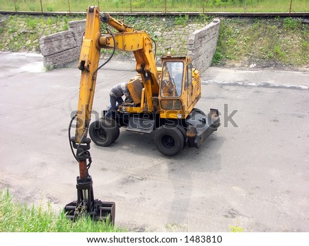 Mechanician servicing the digger - stock photo