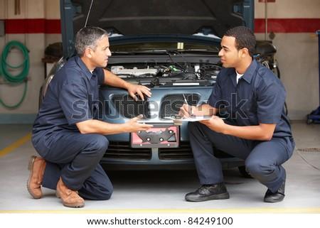 Mechanics at work - stock photo