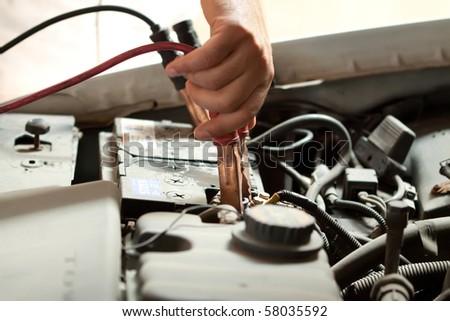 Mechanics checking the car engine - stock photo