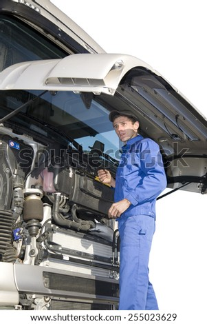 mechanics working on truck, isolated on white - stock photo