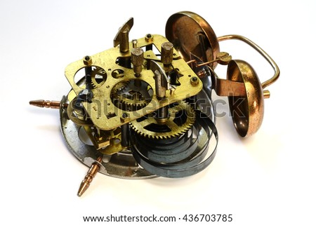 mechanism of old vintage alarm clock on a white background - stock photo