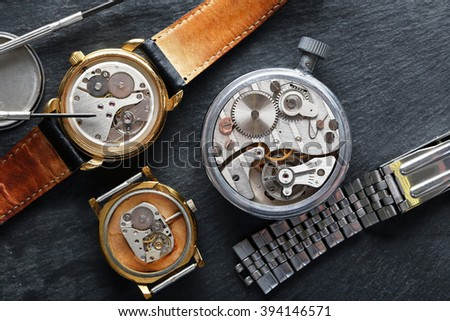 Mechanism of old watch co table closeup - stock photo