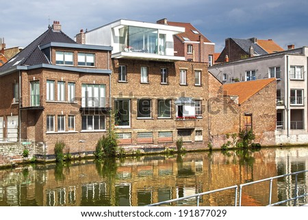 MECHELEN, BELGIUM - AUGUST 05, 2012: The historic houses along the canal at Zoutwerf. Mechelen is one of Flanders' prominent art cities, with Brussels, Antwerp, Bruges, Ghent, and Leuven. - stock photo