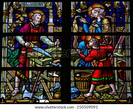 MECHELEN, BELGIUM - JANUARY 31, 2015: Stained Glass window depicting Joseph, Maria and Jesus, in the Cathedral of Saint Rumbold in Mechelen, Belgium. - stock photo
