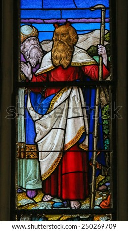 MECHELEN, BELGIUM - JANUARY 31, 2015: Stained Glass window depicting Moses, in the Cathedral of Saint Rumbold in Mechelen, Belgium. - stock photo