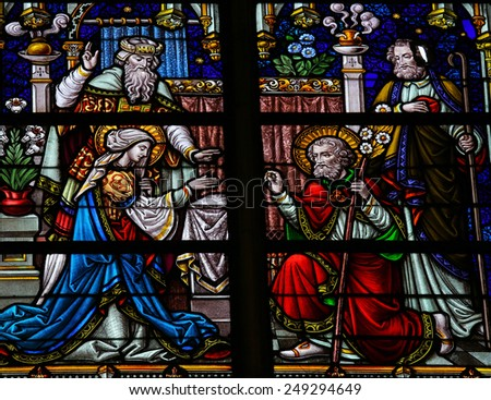 MECHELEN, BELGIUM - JANUARY 31, 2015: Stained Glass window depicting the Wedding of Joseph and Mother Mary, in the Cathedral of Saint Rumboldt in Mechelen, Belgium. - stock photo