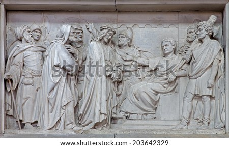 MECHELEN, BELGIUM - JUNE 14, 2014: Stone relief Jesus from Pilate in church Our Lady across de Dyle.