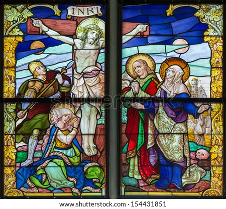 MECHELEN, BELGIUM - SEPTEMBER 6: Crucifixion scene from windowpane of St. Rumbold's cathedral on Sepetember 6, 2013 in Mechelen, Belgium.