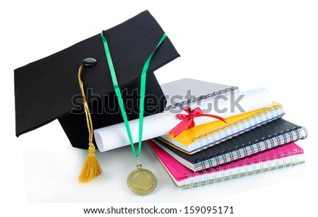Medal for achievement in education,diploma, hat and notebooks isolated on white