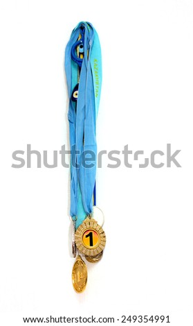 Medal on a white wall - stock photo