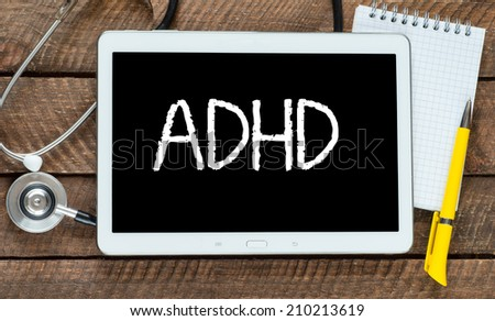 Medecine concept. tablet pc with word ADHD and stethoscope - stock photo