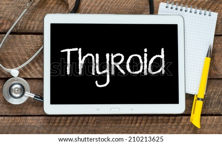 Medecine concept. tablet pc with word Thyroid and stethoscope - stock photo